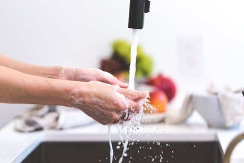 person washing hands